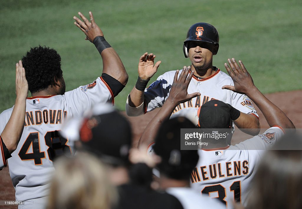 <a gi-track='captionPersonalityLinkClicked' href=/galleries/search?phrase=Emmanuel+Burriss&family=editorial&specificpeople=590006 ng-click='$event.stopPropagation()'>Emmanuel Burriss</a> #2 of the San Francisco Giants, right, is welcomed into the dugout after scoring the winning run during the 11th inning of a baseball game against the San Diego Padres at Petco Park on July 17, 2011 in San Diego, California.