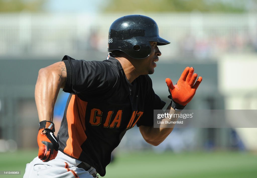<a gi-track='captionPersonalityLinkClicked' href=/galleries/search?phrase=Emmanuel+Burriss&family=editorial&specificpeople=590006 ng-click='$event.stopPropagation()'>Emmanuel Burriss</a> #2 of the San Francisco Giants runs to first base during the preseason game against the Kansas City Royals on March 12, 2012 in Surprise, Arizona.