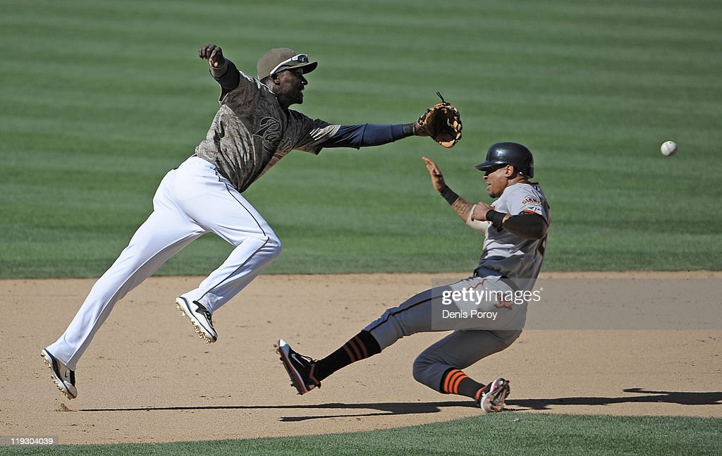 <a gi-track='captionPersonalityLinkClicked' href=/galleries/search?phrase=Emmanuel+Burriss&family=editorial&specificpeople=590006 ng-click='$event.stopPropagation()'>Emmanuel Burriss</a> #2 of the San Francisco Giants steals second base as <a gi-track='captionPersonalityLinkClicked' href=/galleries/search?phrase=Orlando+Hudson&family=editorial&specificpeople=203242 ng-click='$event.stopPropagation()'>Orlando Hudson</a> #1 of the San Diego Padres fields a throw during the 11th inning of a baseball game at Petco Park on July 17, 2011 in San Diego, California.