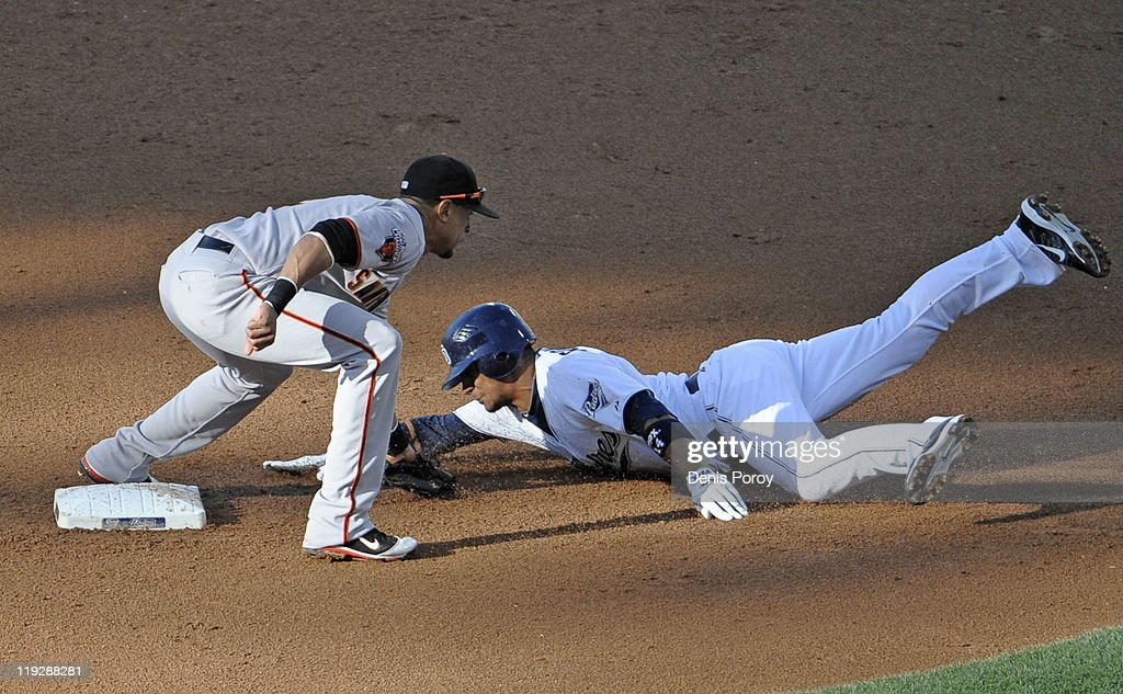 <a gi-track='captionPersonalityLinkClicked' href=/galleries/search?phrase=Emmanuel+Burriss&family=editorial&specificpeople=590006 ng-click='$event.stopPropagation()'>Emmanuel Burriss</a> #2 of the San Francisco Giants tags out Alberto Gonzalez #14 of the San Diego Padres as he tries to steal second base during the third inning of a baseball game at Petco Park on July 16, 2011 in San Diego, California.