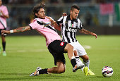 Emmanuel Cascione of Cesena and Sebastian Giovinco of Juventus in action during the preseason friendly match between AC Cesena and Juventus FC at...