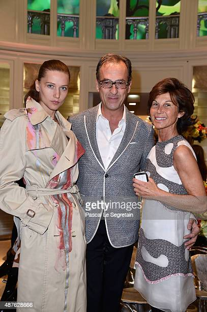 Emmanuel de Brantes standing between Sylvie Rousseau and Guest attend the 'Vendanges Montaigne 2015' at Dior at Avenue Montaigne on September 10 2015...