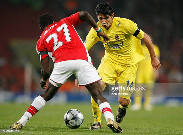 Emmanuel Eboue of Arsenal and Mati Fernandez of Villarreal during the UEFA Champions League Quarter Final 2nd Leg match between Arsenal and...