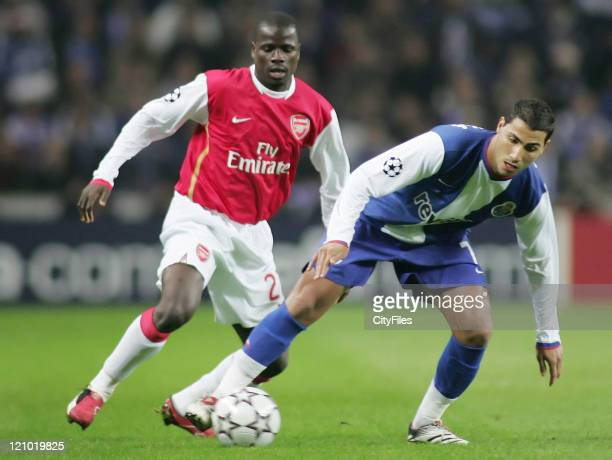 Emmanuel Eboue of Arsenal and Ricardo Quaresma of Porto in action during the UEFA Champions League Group G match between FC Porto and Arsenal at...