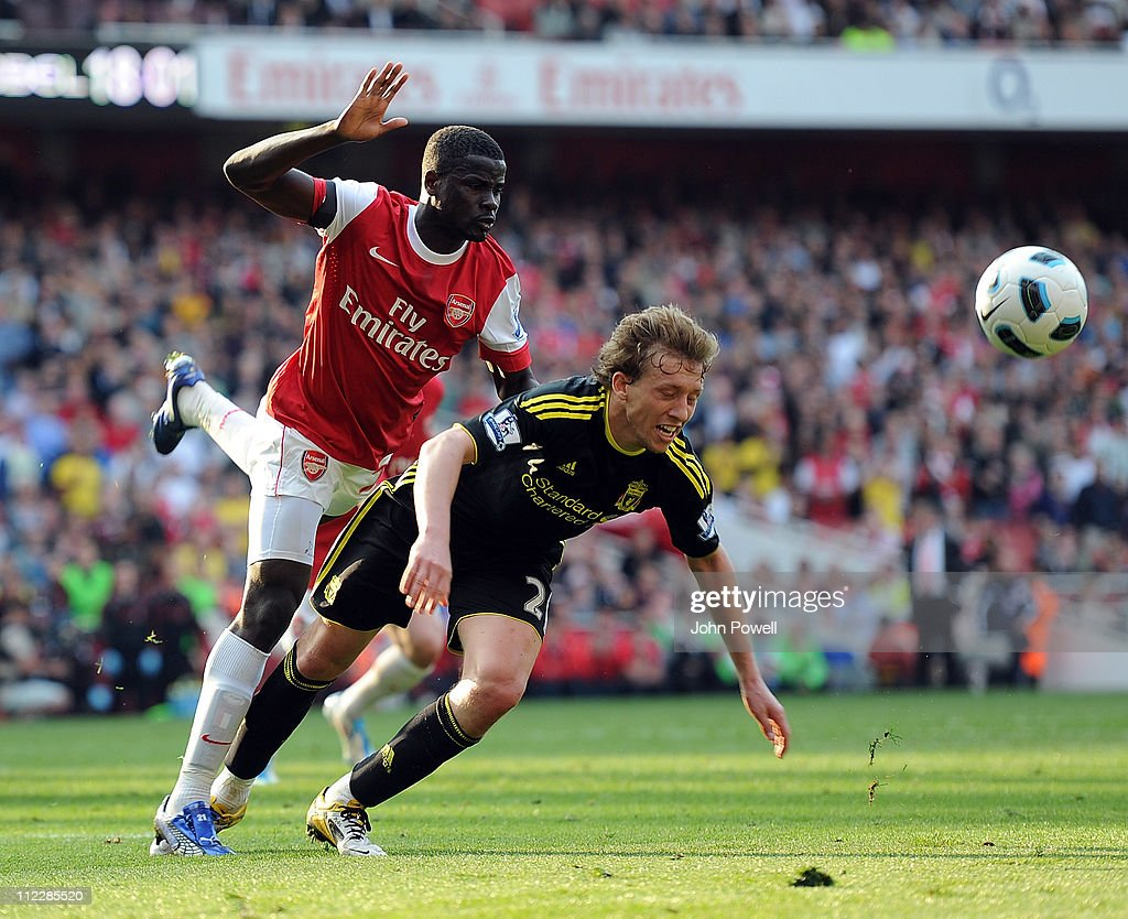 Emmanuel Eboue of Arsenal brings Lucas Leiva of Liverpool in the box for a penilty during the Barclays Premier League match between Arsenal and Liverpool at The Emirates Stadium at on April 17, 2011 in London, England.
