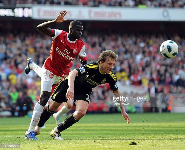 Emmanuel Eboue of Arsenal brings Lucas Leiva of Liverpool in the box for a penilty during the Barclays Premier League match between Arsenal and...