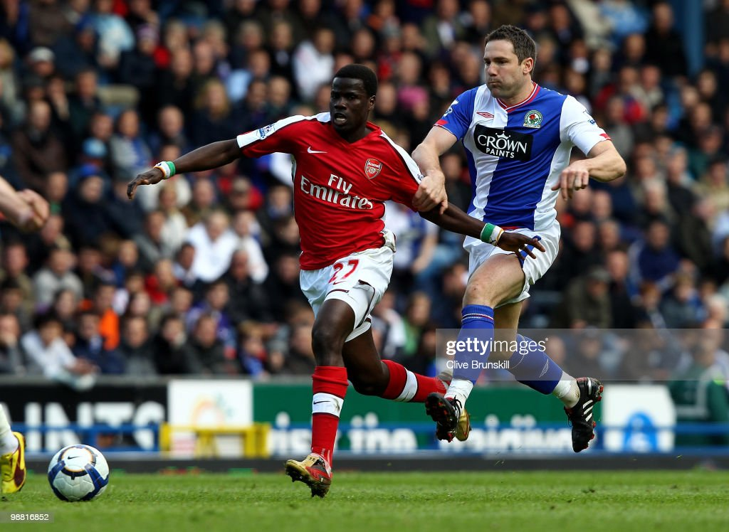 Emmanuel Eboue of Arsenal moves away from David Dunn of Blackburn Rovers during the Barclays Premier League match between Blackburn Rovers and Arsenal at Ewood Park on May 3, 2010 in Blackburn, England.