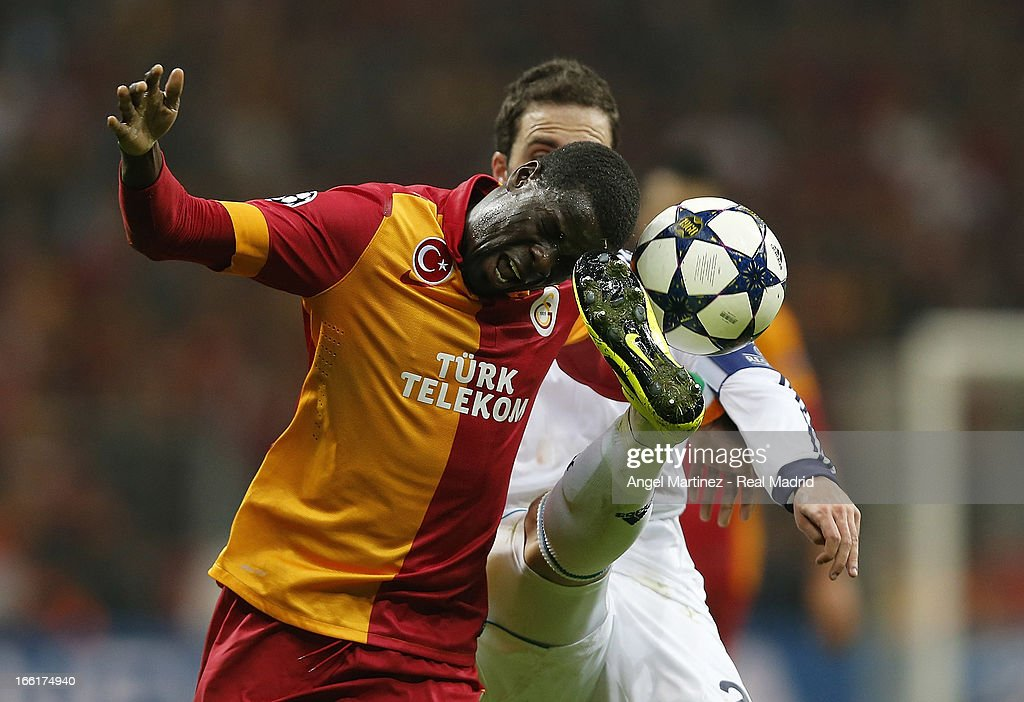 <a gi-track='captionPersonalityLinkClicked' href=/galleries/search?phrase=Emmanuel+Eboue&family=editorial&specificpeople=564874 ng-click='$event.stopPropagation()'>Emmanuel Eboue</a> of Galatasaray competes for the ball with <a gi-track='captionPersonalityLinkClicked' href=/galleries/search?phrase=Gonzalo+Higuain&family=editorial&specificpeople=651523 ng-click='$event.stopPropagation()'>Gonzalo Higuain</a> of Real Madrid during the UEFA Champions League Quarter Final second leg match between Galatasaray and Real Madrid at Ali Sami Yen Spor Kompleksi on April 9, 2013 in Istanbul, Turkey.