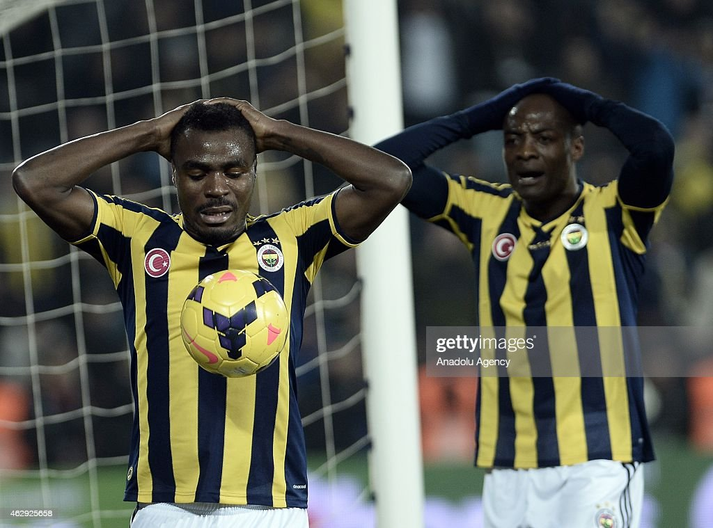 <a gi-track='captionPersonalityLinkClicked' href=/galleries/search?phrase=Emmanuel+Emenike&family=editorial&specificpeople=7487637 ng-click='$event.stopPropagation()'>Emmanuel Emenike</a> (L) and <a gi-track='captionPersonalityLinkClicked' href=/galleries/search?phrase=Pierre+Webo&family=editorial&specificpeople=790636 ng-click='$event.stopPropagation()'>Pierre Webo</a> (R) of Fenerbahce reacts after a position during the Turkish Spor Toto Spor League soccer match between Fenerbahce and Trabzonspor at Sukru Saracoglu Stadium in Istanbul, Turkey on February 07, 2015.