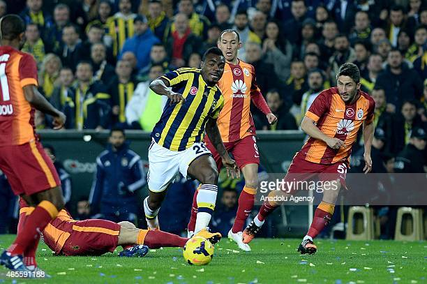 Emmanuel Emenike of Fenerbahce and Sabri Sarioglu of Galatasaray in action during the Turkish Spor Toto Super League derby game between Fenerbahce...