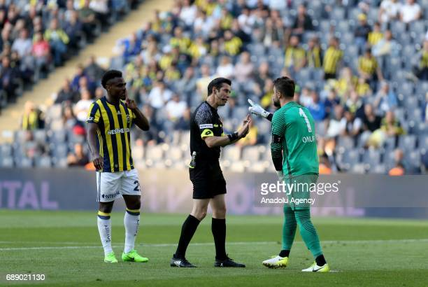 Emmanuel Emenike of Fenerbahce argues with Onur Kivrak of Trabzonspor during the Turkish Spor Toto Super Lig soccer match between Fenerbahce and...