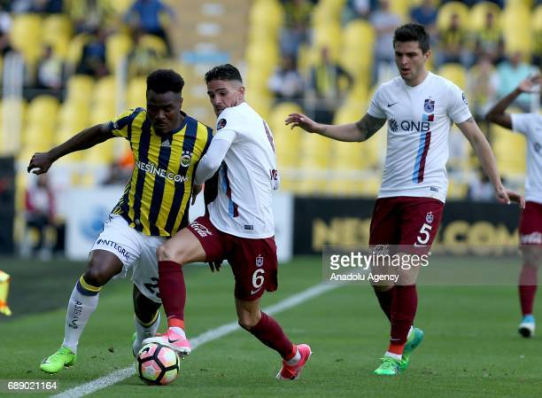 Emmanuel Emenike of Fenerbahce in action against Carl Medjani of Trabzonspor during the Turkish Spor Toto Super Lig soccer match between Fenerbahce...