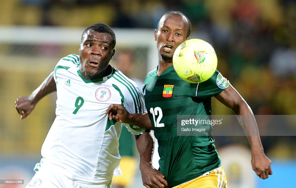 AFRICA - JANUARY 29, Emmanuel Emenike of Nigeria and Biyadiglign Elyas of Ethiopia during the 2013 African Cup of Nations match between Ethiopia and Nigeria at Royal Bafokeng Stadium on January 29, 2013 in Rustenburg, South Africa.