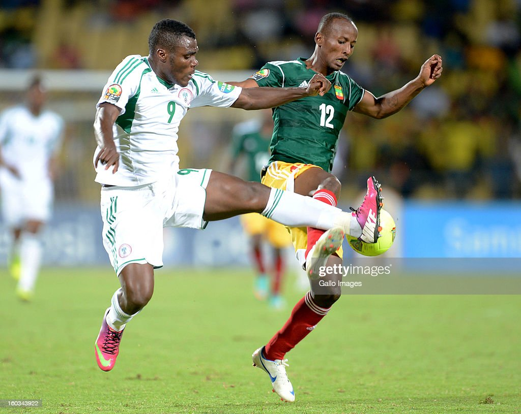 AFRICA - JANUARY 29, Emmanuel Emenike of Nigeria and Biyadiglign Elyas of Ethiopia in action during the 2013 African Cup of Nations match between Ethiopia and Nigeria at Royal Bafokeng Stadium on January 29, 2013 in Rustenburg, South Africa.