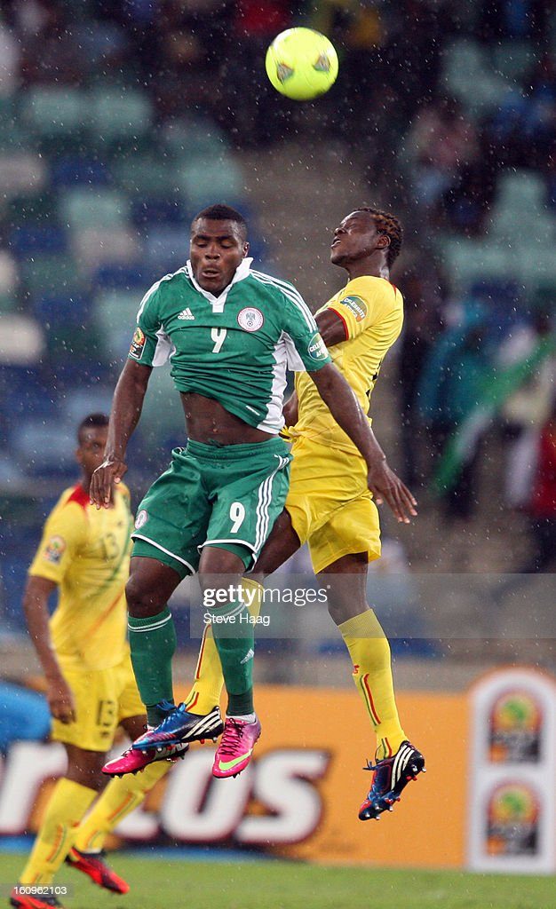 Emmanuel Emenike of Nigeria and Mahamadou Ndiaye of Mali both miss the ball during the 2013 African Cup of Nations Semi-Final match between Mali and Nigeria at Moses Mahbida Stadium on February 06, 2013 in Durban, South Africa.