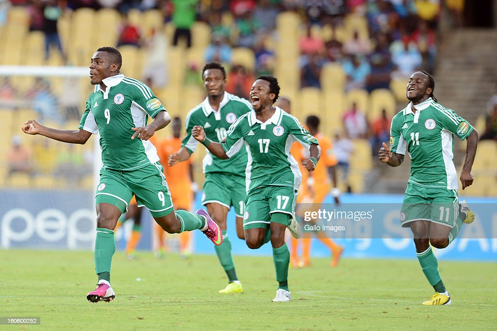 Emmanuel Emenike(L) of Nigeria celebrates scoring a goal during the 2013 Orange African Cup of Nations 3rd Quarter Final match between Ivory Coast and Nigeria, at Royal Bafokeng Stadium on February 03, 2013 in Rustenburg, South Africa.