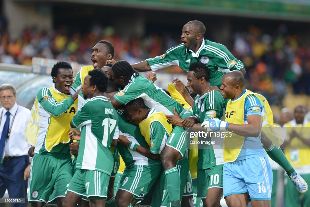 Emmanuel Emenike (9) of Nigeria celebrates scoring a goal with his teamamtes during the 2013 Orange African Cup of Nations 3rd Quarter Final match between Ivory Coast and Nigeria, at Royal Bafokeng Stadium on February 03, 2013 in Rustenburg, South Africa.
