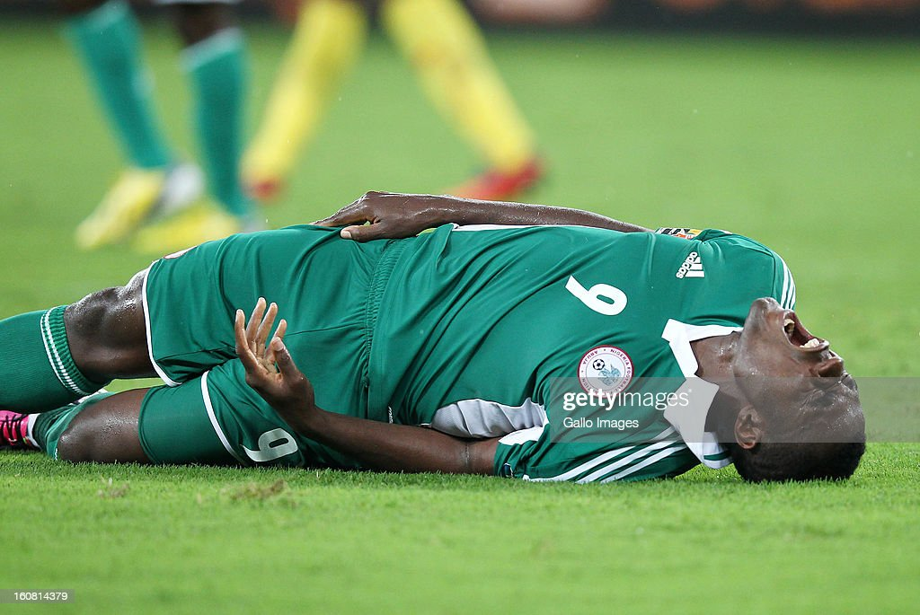 <a gi-track='captionPersonalityLinkClicked' href=/galleries/search?phrase=Emmanuel+Emenike&family=editorial&specificpeople=7487637 ng-click='$event.stopPropagation()'>Emmanuel Emenike</a> of Nigeria lies on the pitch during the 2013 Orange African Cup of Nations 1st Semi Final match between Mali and Nigeria at Moses Mabhida Stadium on February 06, 2013 in Durban, South Africa.