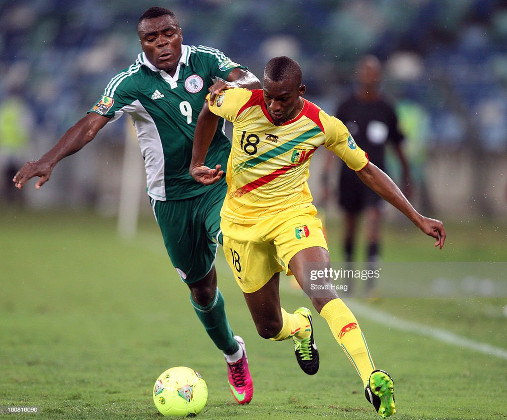 Emmanuel Emenike of Nigeria tackles Samba Sow of Mali during the 2013 African Cup of Nations Semi-Final match between Mali and Nigeria at Moses Mahbida Stadium on February 06, 2013 in Durban, South Africa.