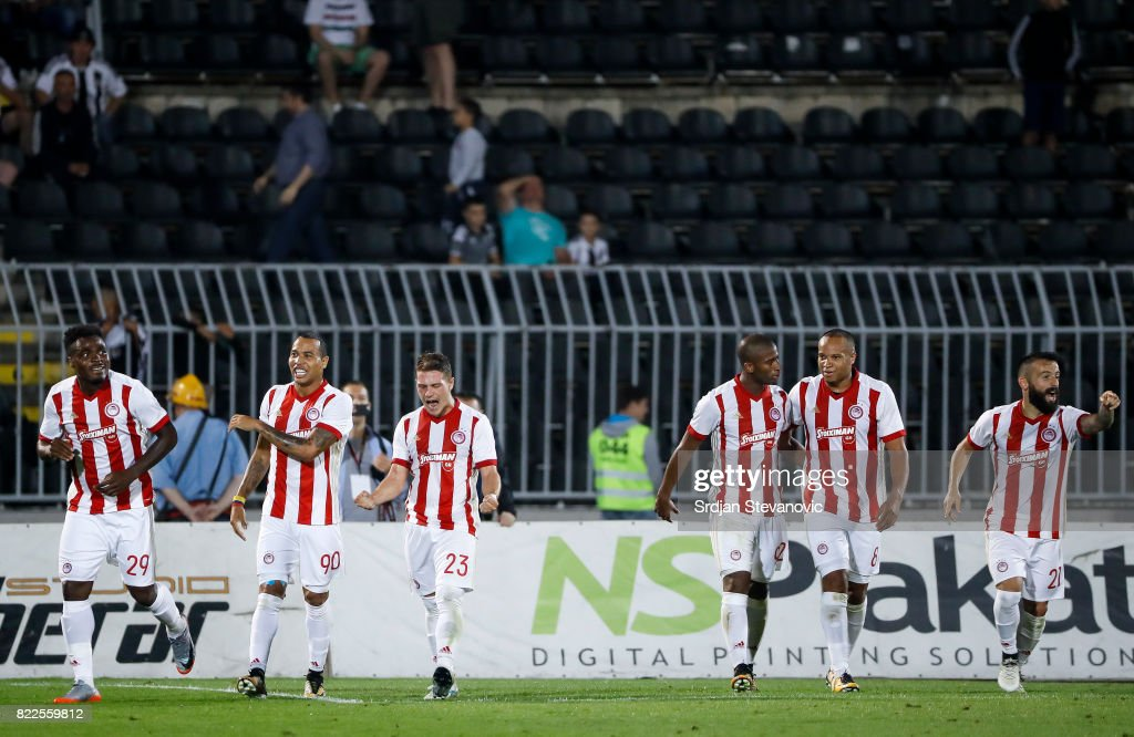Emmanuel Emenike (L) of Olympiacos celebrate scoring the goal with Felipe Pardo (C) and Leonardo Koutris (R) during the UEFA Champions League Qualifying match between FC Partizan and Olympiacos on July 25, 2017 in Belgrade, Serbia.