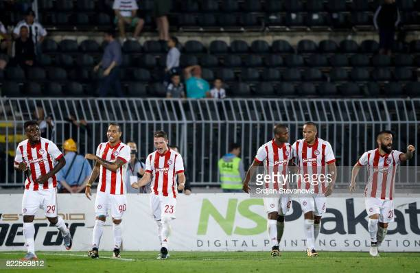 Emmanuel Emenike of Olympiacos celebrate scoring the goal with Felipe Pardo and Leonardo Koutris during the UEFA Champions League Qualifying match...