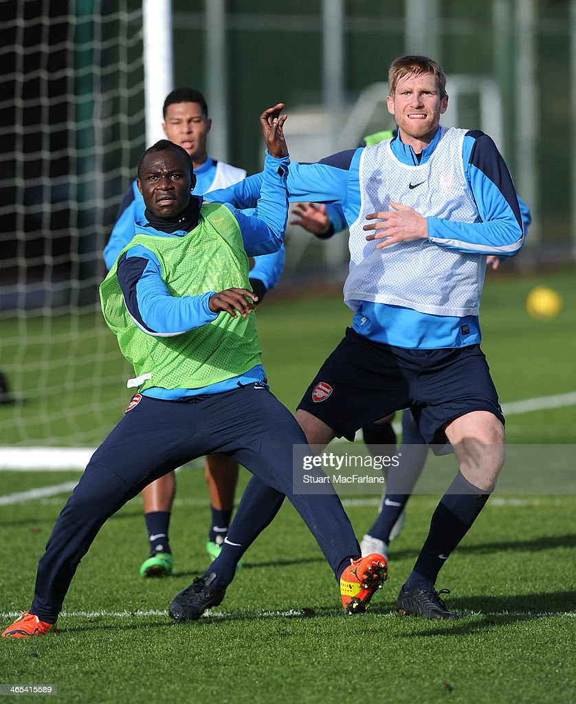 Emmanuel Frimpong and Per Mertesacker of Arsenal during a training session at London Colney on January 27, 2014 in St Albans, England.