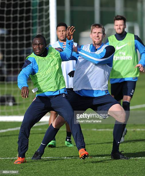 Emmanuel Frimpong and Per Mertesacker of Arsenal during a training session at London Colney on January 27 2014 in St Albans England