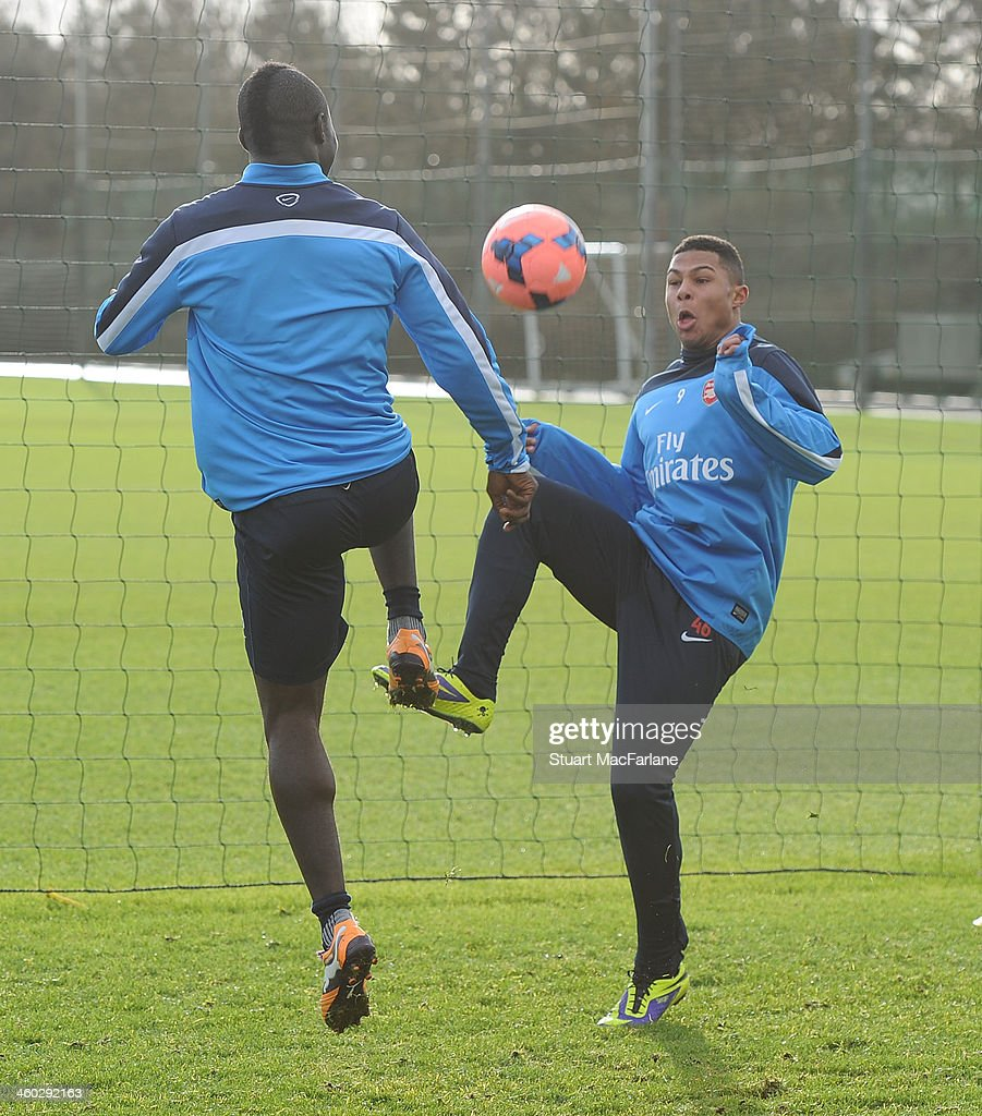 Emmanuel Frimpong and Serge Gnabry of Arsenal compete for the ball during a training session at London Colney on January 3 2014 in St Albans England