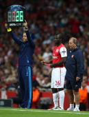 Emmanuel Frimpong of Arsenal prepares to come on as a substitute during the UEFA Champions League playoff first leg match between Arsenal and Udinese...