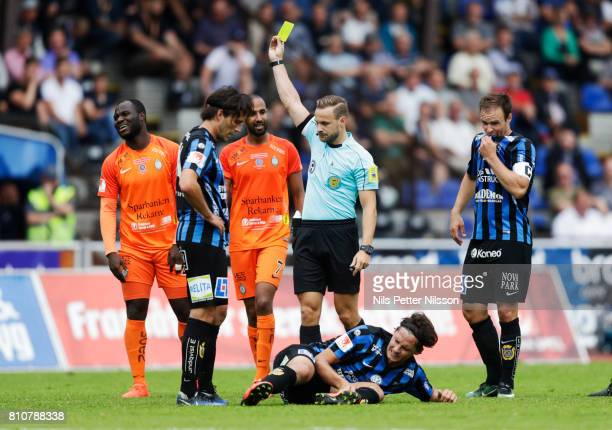 Emmanuel Frimpong of Athletic FC Eskilstuna is shown a yellow card by Kristoffer Karlsson referee during the Allsvenskan match between IK Sirius FK...