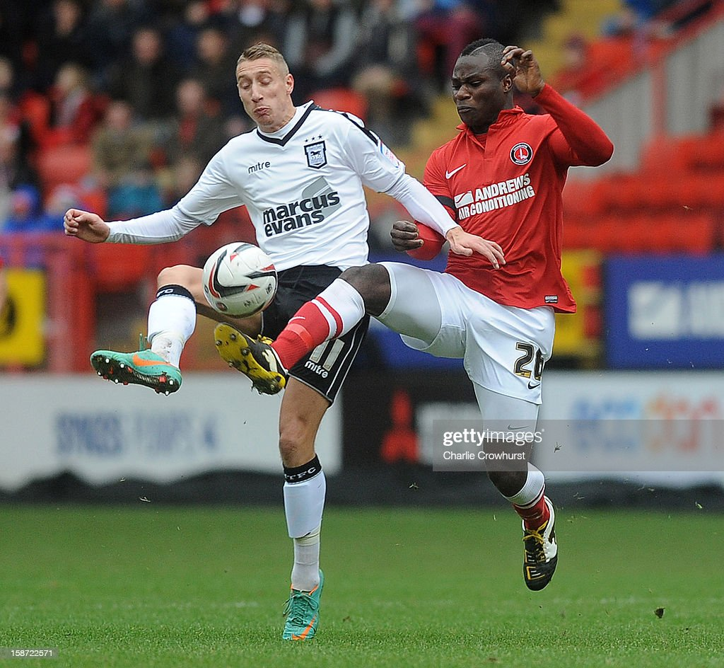 <a gi-track='captionPersonalityLinkClicked' href=/galleries/search?phrase=Emmanuel+Frimpong&family=editorial&specificpeople=5014743 ng-click='$event.stopPropagation()'>Emmanuel Frimpong</a> of Charlton Athletic battles with <a gi-track='captionPersonalityLinkClicked' href=/galleries/search?phrase=Lee+Martin+-+Soccer+Player+-+Born+1987&family=editorial&specificpeople=15382346 ng-click='$event.stopPropagation()'>Lee Martin</a> of Ipswich during the npower Championship match between Charlton Athletic and Ipswich Town at The Valley on December 26, 2012 in London, England.