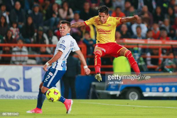 Emmanuel Garcia of Pachuca observes as Raul Ruidiaz of Morelia kicks the ball during the 10th round match between Pachuca and Morelia as part of the...