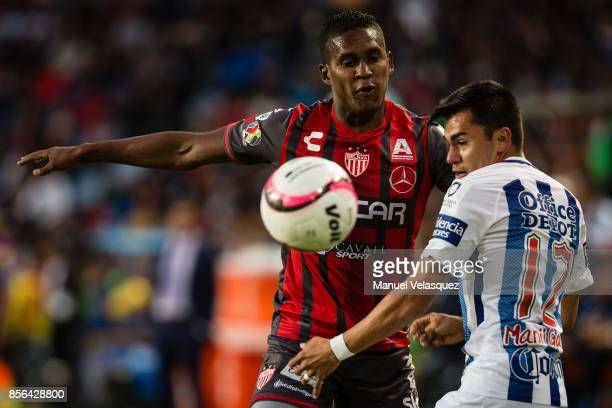 Emmanuel Garcia of Pachuca struggles for the ball with Brayan Beckeles of Necaxa during the 12th round match between Pachuca and Necaxa as part of...
