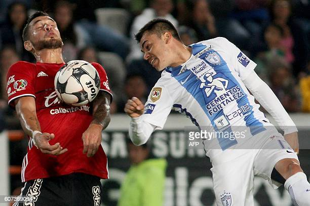 Emmanuel Garcia of Pachuca vies for the ball with Milton Caralaglio of Tijuana during their Mexican Clausura 2016 Tournament football match at...