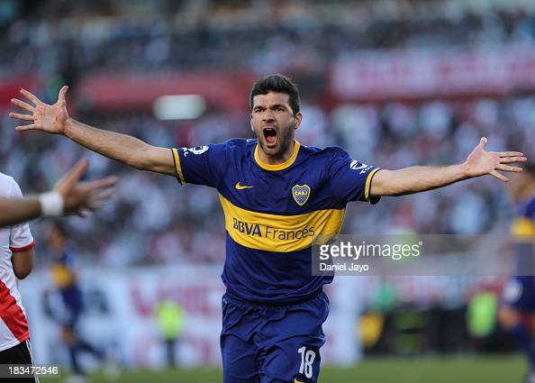 Emmanuel Gigliotti of Boca Juniors celebrates after scoring during a match between River Plate and Boca Juniors as part of the Torneo Inicial 2013 at...