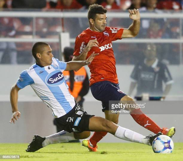 Emmanuel Gigliotti of Independiente fights for the ball with Teodoro Paredes of Atletico Rafaela during a match between Independiente and Atletico de...