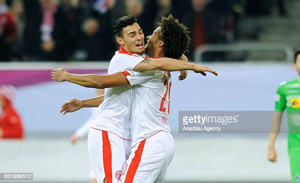 Emmanuel Iyoha and Kaan Ayhan of Fortuna Duesseldorf celebrate scoring a goal during the Telekom Cup match between Borussia Moenchengladbach and...