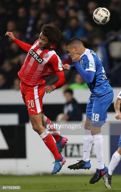 Emmanuel Iyoha of Duesseldorf is challenged by Jan Gyamerah of Bochum during the Second Bundesliga match between VfL Bochum 1848 and Fortuna...