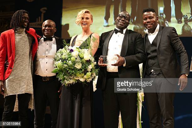 Emmanuel Jal Danny Damah Charlize Theron Tony Tagoe and Kweku Mandela during the Cinema For Peace Gala 2016 during the 66th Berlinale International...