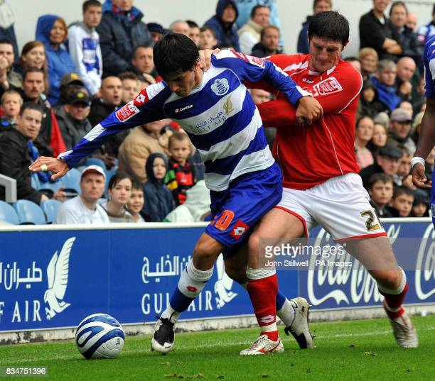 Emmanuel Ledesma of Queen's Park Rangers in action against John Macken of Barnsley during the CocaCola Football Championship match at Loftus Road...