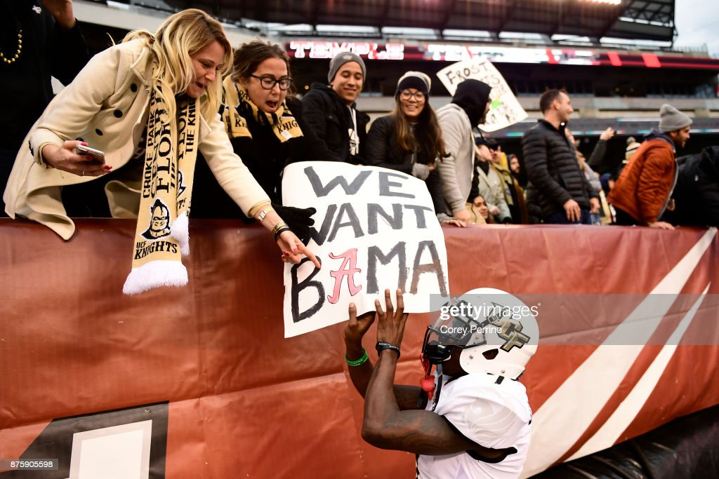 Emmanuel Logan-Greene #7 of the UCF Knights touches a fan's sign after the win at Lincoln Financial Field on November 18, 2017 in Philadelphia, Pennsylvania. UCF defeated Temple 45-19.