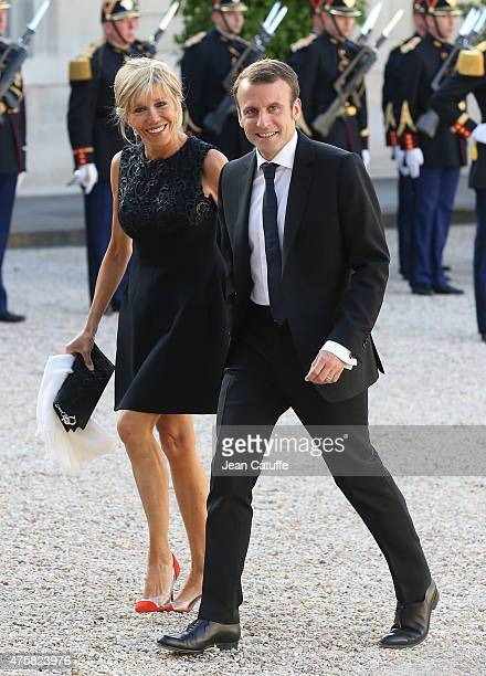 Emmanuel Macron and his wife Brigitte Trogneux arrive at the State Dinner offered by French President Francois Hollande in honor to the King and...