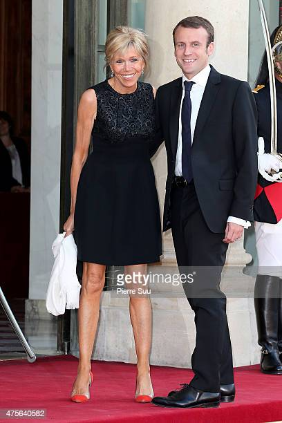 Emmanuel Macron and his wife Brigitte Trogneux attend a state dinner in Honnor of King Felipe VI and Queen Letizia of Spain at the Elysee Palace on...