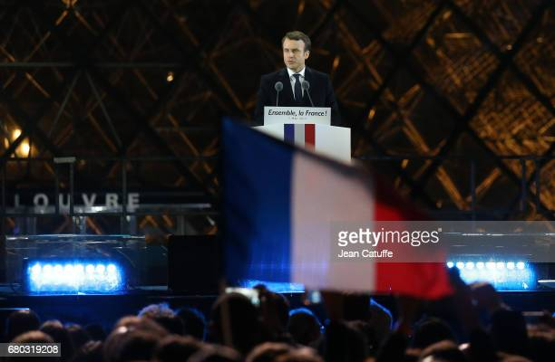 Emmanuel Macron celebrates his presidential election victory at Le Louvre plaza on May 7 2017 in Paris France