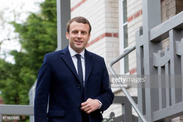 Emmanuel Macron France's independent presidential candidate leaves his house to return to Paris after voting in Le Touquet France on Sunday April 23...