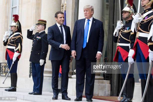 Emmanuel Macron France's president center left and US President Donald Trump center right pose for photographs at the Elysee Palace in Paris France...