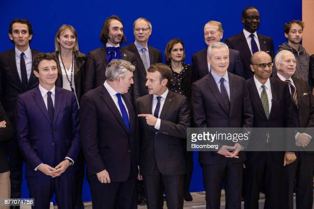 Emmanuel Macron France's president center speaks with Gordon Brown former UK prime minister as Bruno Le Maire France's finance minister center right...