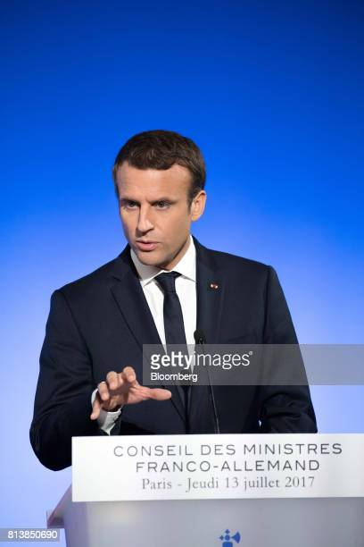 Emmanuel Macron France's president gestures while speaking during a news conference with Germany's Chancellor Angela Merkel following a FrancoGerman...