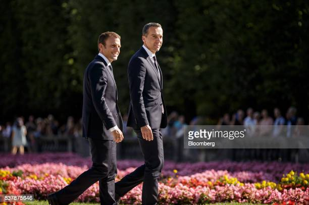 Emmanuel Macron France's president left and Christian Kern Austria's chancellor walk through the Mirabell Gardens in Salzburg Austria on Wednesday...