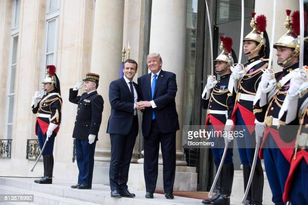 Emmanuel Macron France's president left and US President Donald Trump shake hands while posing for photographs at the Elysee Palace in Paris France...
